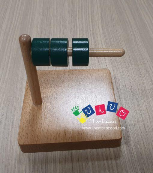 3 dischi su piolo orizzontale in legno